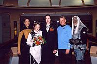 Art and Patty pose with the Enterprise crew who served during our wedding.